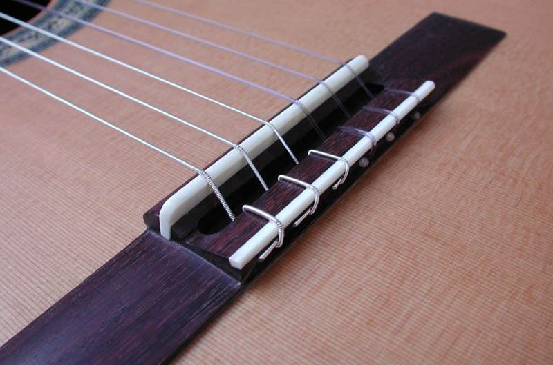 How Nylon And Steel String Instrument Bridges Differ