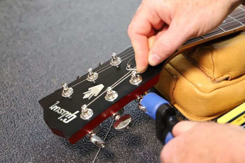 How to wind a guitar string electric