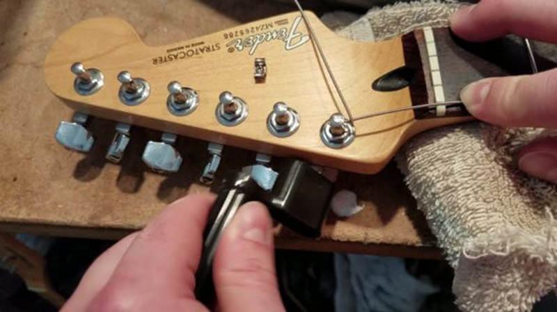 Restring electric guitar locking method